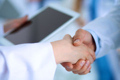 Young medical people handshaking at office Royalty Free Stock Photography