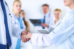 Young medical people handshaking at office Stock Image