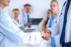 Young medical people handshaking at office Royalty Free Stock Images