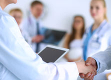 Young medical people handshaking at office Stock Photo
