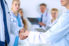 Young medical people handshaking at office Stock Images