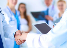 Young medical people handshaking at office Stock Photos