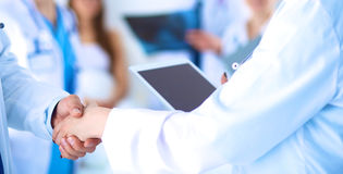 Young medical people handshaking at office Royalty Free Stock Photos
