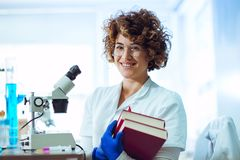Young medical student with books. In laboratory stock image