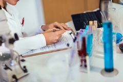 Young medical student learning and writes in laboratory. Close up stock images