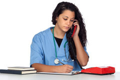 Young medical student with a phone. On white background Royalty Free Stock Photo