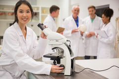 Young medical student working with microscope Royalty Free Stock Photos