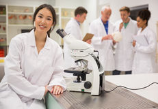 Young medical student working with microscope Stock Photo