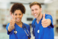 Young medical students showing thumbs up Stock Images