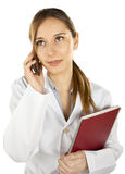 Young medical woman calling by mobile phone Stock Image