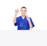 Young medical worker clicking on an imaginary display Royalty Free Stock Images