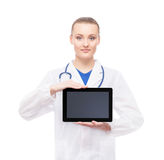 Young medical worker holding a tablet on white Royalty Free Stock Photography