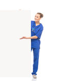 Young medical worker posing with a large banner Stock Image