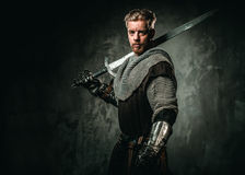 Medieval knight with sword and armour Royalty Free Stock Images