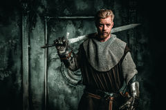 Medieval knight with sword and armour stock image