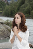 Young meditating caucasian woman outdoors in nature royalty free stock image