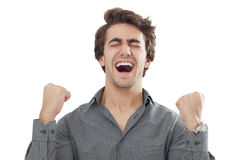 Young men with arms up celebrating his success Royalty Free Stock Photos