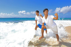 Young men on beach Stock Photography