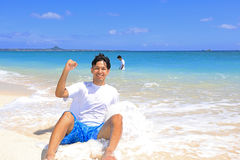 Young men on beach Royalty Free Stock Photography