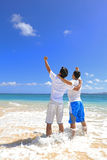 Young men on beach Stock Images