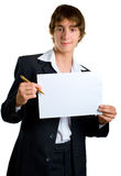 Young men in black shows empty sheet Royalty Free Stock Photos