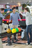 Young men bowling poised to high five royalty free stock photos