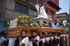 Young men carrying a heavy Easter float in Guatemala Royalty Free Stock Photos