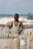 Young men catch fish on the bank of the river of Congo. Stock Images