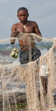 Young men catch fish on the bank of the river of Congo. Royalty Free Stock Photography