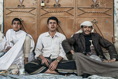 Young men chewing khat qat narcotic drug leaves in yemen Stock Photo
