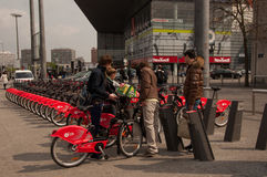Young men with city-bikes in Lille, France Royalty Free Stock Images