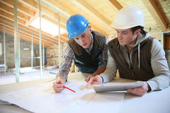 Young men in construction professional training. Young men in professional training working on building site Royalty Free Stock Photo