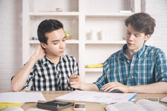 Young men discussing construction project Stock Photos