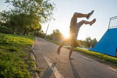 Young men doing athletic exercise Royalty Free Stock Photos