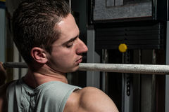 Young men doing heavy weight exercise for back Royalty Free Stock Image