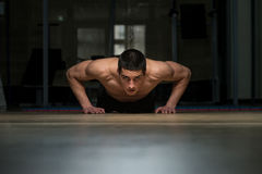 Young Men Doing Press Ups In Gym Stock Image