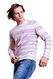 Young men dressed in modern clothes. In a sweater and jeans Stock Photos