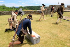 Young men dressed in period clothing,demonstrating canon firings, Fort Ticonderoga, New York, 2016 Royalty Free Stock Images