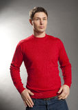 Young men dressed in red sweater Stock Photos