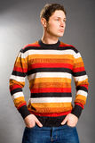 Young men dressed in sweater Stock Images