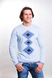 Young men dressed in a sweater and jeans. Young men dressed in modern clothes. In a sweater and jeans Stock Photography