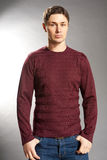 Young men dressed in sweater and jeans Stock Photo