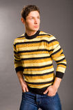 Young men dressed in sweater and jeans Stock Photos