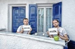 Young men drink milk Stock Image