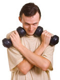 Young men with dumbbells Royalty Free Stock Images