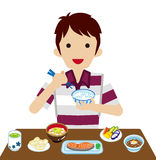 Young men eating Japanese breakfast Royalty Free Stock Photography