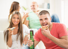 Young men eating pizza Stock Photo