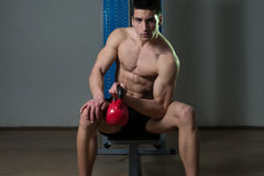 Young Men Exercise With Kettle Bell Biceps. Teenage Boy Exercise With Kettle Bell Biceps Royalty Free Stock Image