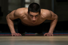Young Men Exercising Push Ups Royalty Free Stock Photography