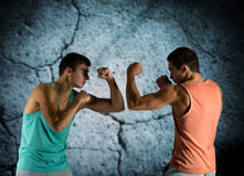 Young men fighting hand-to-hand Royalty Free Stock Photography
